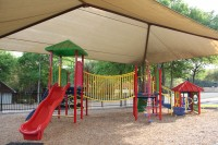 Here is a close-up of the covered playground in Scofield Farms.  What a great idea to cover the play area so that the kiddos can enjoy themselves without being torched by the Texas sun!